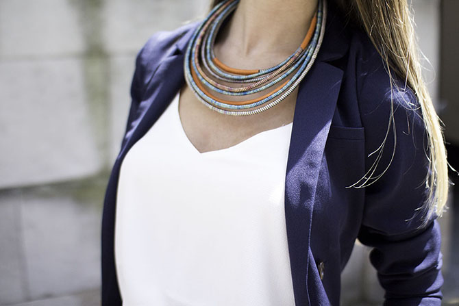 navy-suit-orange-necklace